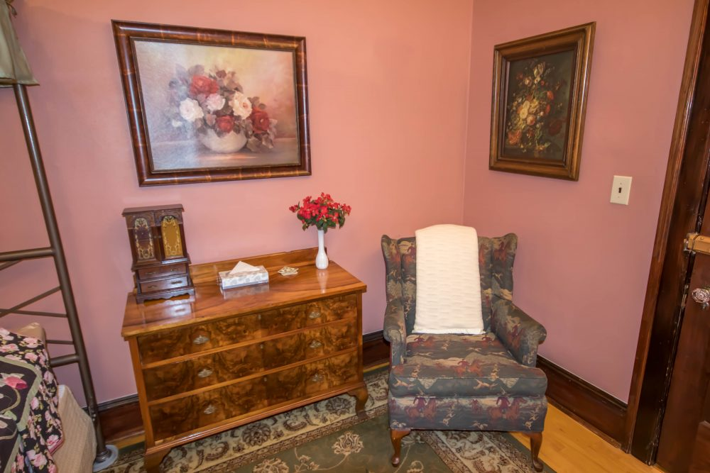 Hotel room sitting area with floral paintings