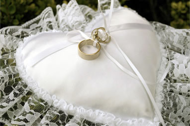 Wedding pillow with rings on top