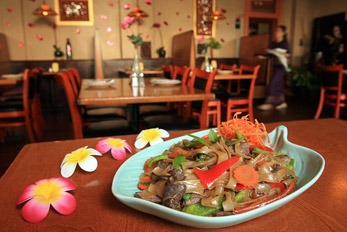 Thai food with flowers on a table